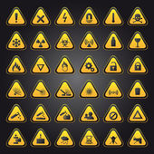 Yellow warning and danger signs — Stockvector