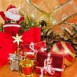 Christmas presents and ornaments on orange — Stock Photo #16697367