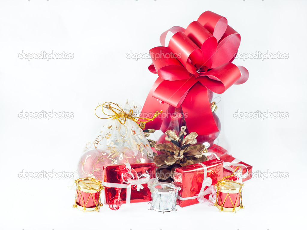 Christmas presents and ornaments on white background — Stock Photo #16697343
