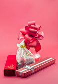 Jewelry red boxes and gift balls — Stock Photo