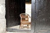 Door with chair — Stock Photo