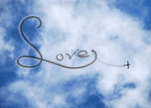 Clouds and plane in love — Stock Photo