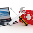 Laptop with tools and a first aid kit on a white background — Stock Photo #30304279