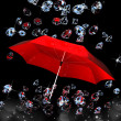 Diamond under the umbrella red on black background — Stock Photo