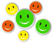 Color smiley faces with reflection on white — Stock Photo