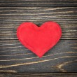 Red heart on old wooden background — Stockfoto #39497569