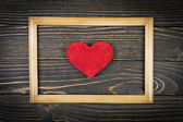 Red heart on an old wooden background — Stock Photo
