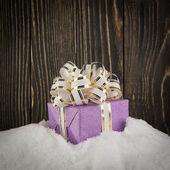 Presents on a snow background — Stock Photo