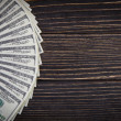 Stock Photo: Dollars on wood old background