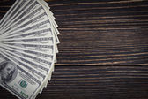 Dollars on wood old background — Stock Photo