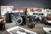 Old camera on the wooden table — Stock Photo