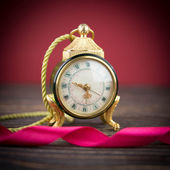 Vintage background with retro alarm clock — Photo
