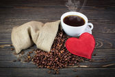 Coffee bean background with heart — Stock Photo