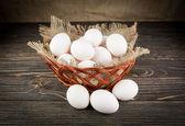 Eggs isolated on wood background — Stock Photo