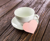 Tea ceremony with heart on an old wooden background — Stock Photo