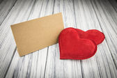 Red heart on wood background — Stockfoto