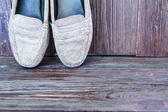 Old shoes on wood background — Stock Photo