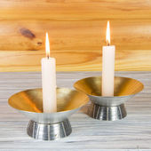 Candle on wood background — Stok fotoğraf