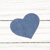 Jeans texture Heart shape on wood background — Zdjęcie stockowe