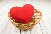 Red heart on wood background — Zdjęcie stockowe