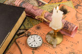 Antiquarian pocket watch and ancient world maps — Stock Photo