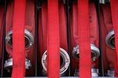 Fire-hose set in hose station — Stock Photo