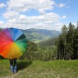 Rainbow umbrella at the Alps — Stok fotoğraf