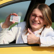 Woman with driving licence — Stock Photo