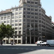 Traffic in Downtown Gran Via and Passeig De Gracia crossing - Stock Photo