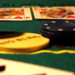 Chips with cards on a poker table — Stock Video #16033397