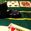 Chips with cards on a poker table — Stock Video #16035423
