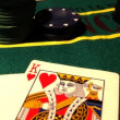 Chips with cards on a poker table — Stock Video #16036861