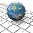 Earth on keyboard — Stock Photo