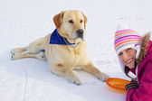 Girl with her dog in winter — Stock Photo
