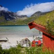 Fishing hut by fjord — Stock Photo