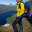 Hiker above fjord — Stock Photo