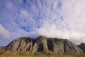 Clouds over cliffs — Stock Photo