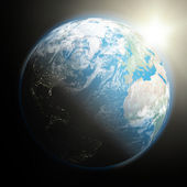 Nascer do sol sobre a terra — Foto Stock