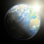 Východ slunce nad zemi — Stock fotografie