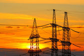 High-voltage support against the sunset sky — Stock Photo