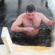Orthodox believer takes a dip in ice cold water — Stock Photo