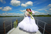Wedding.Honeymoon trip on the yacht. — Stock Photo