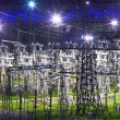 Foto Stock: Electric substation in night-time lighting