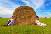 Groom and bride in the field — Stock Photo