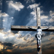 Cross of Jesus Christ against the beautiful sky - Stock Photo