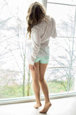Pretty woman standing near the window — Stock Photo