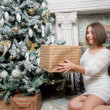 Young beautiful woman in white dress and christmass tree — Stock Photo