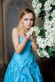 Young beautiful woman in blue wedding dress — Stock Photo