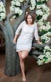 Young beautiful woman in white dress — Stock Photo