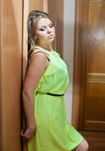 Portrait of young woman in bright green dress — Stock fotografie
